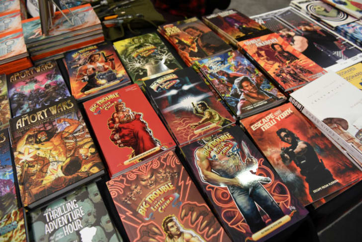 A selection of hardbound comic book titles and graphic novels are seen on display at New York Comic Con at the Jacob K. Javits Convention Center in 2018