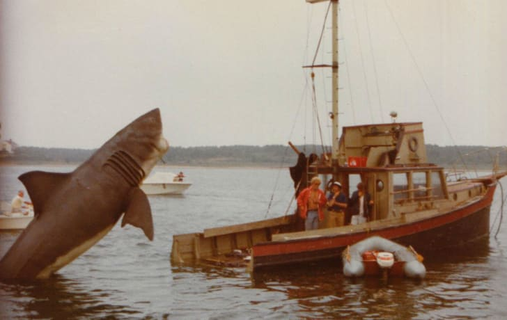A mechanical shark attacks the replica 'Orca II' boat during filming of 1975's 'Jaws'