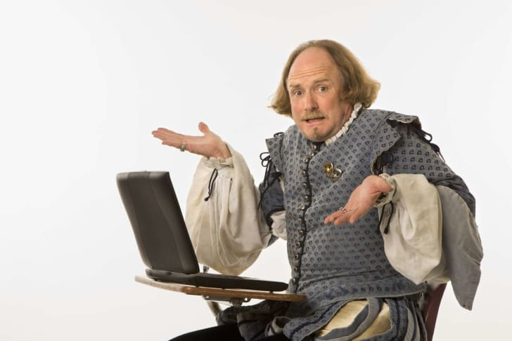 shakespeare impersonator at a laptop