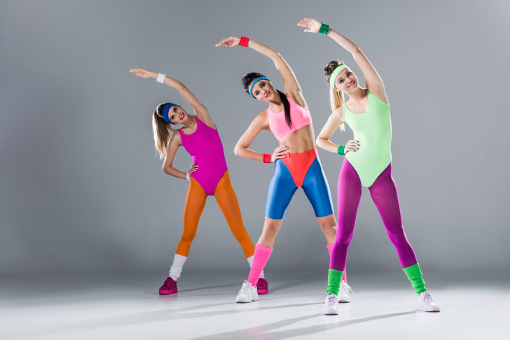 Young women doing aerobics in totally '80s outfits