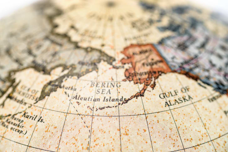 A globe with Alaska and the Bering Strait centered.