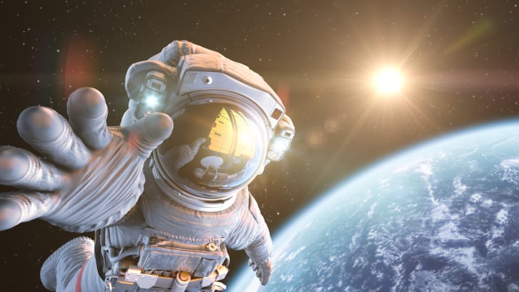 Computer Generated art rendering of an astronaut floating in space above the earth.