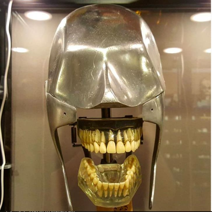 "A ""Dental phantom""—a metal head equipped with teeth."