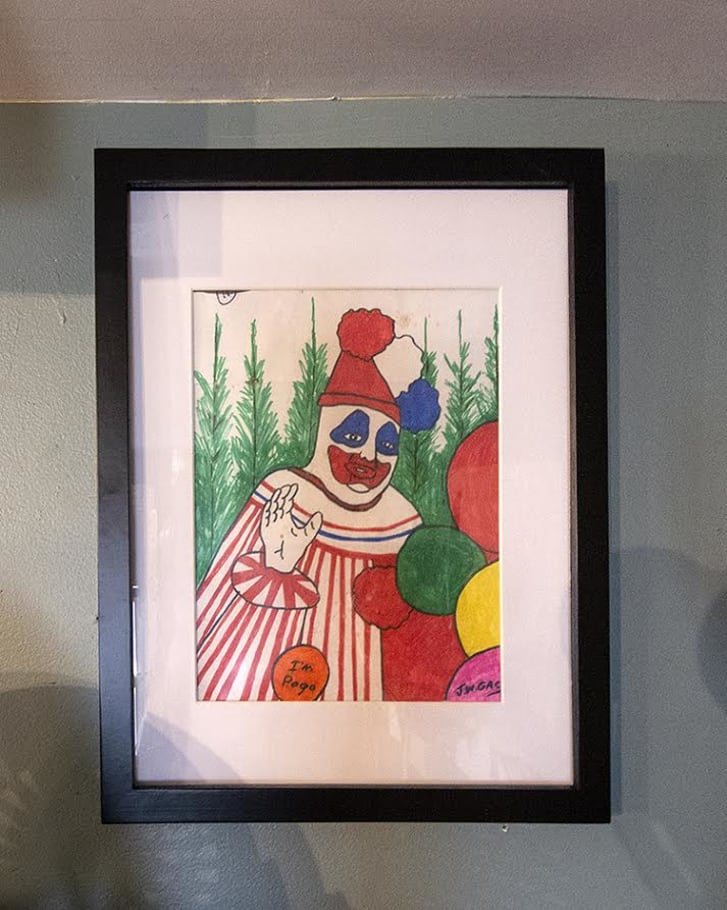 "A marker drawing of a clown waving and saying ""Hi I'm Pogo"" drawn by John Wayne Gacy"