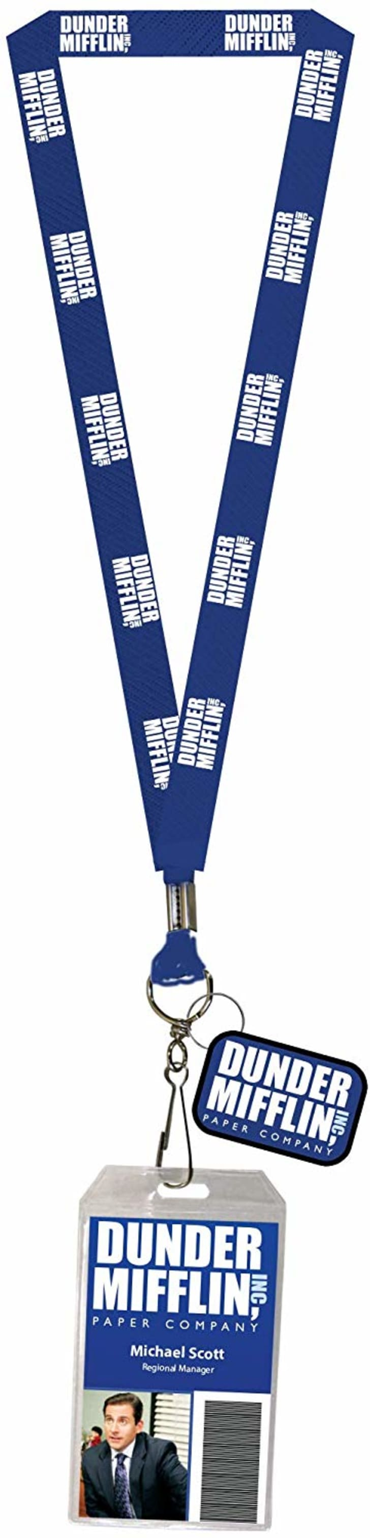 Image of a blue lanyard that features the logo for Dunder Mifflin. The lanyard is attached to a plastic ID cover.