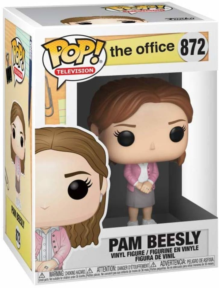 Image of a Pam Beesly Funko Pop figurine inside a box. The figurine has fair skin, medium brown hair, and is wearing a gray skirt and a pink cardigan.