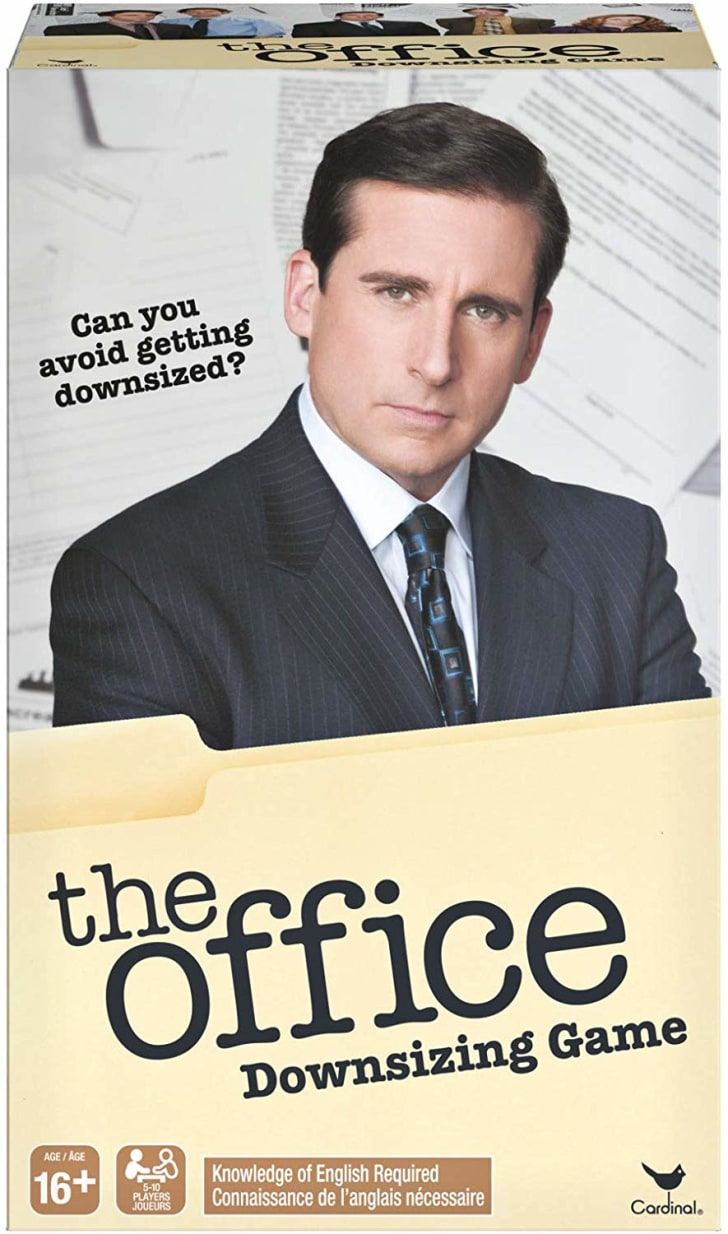 """Image of the box for The Office Downsizing Game. The front of the box features a picture of Steve Carrell as Michael Scott and the tagline """"Can you avoid getting downsized?"""""""