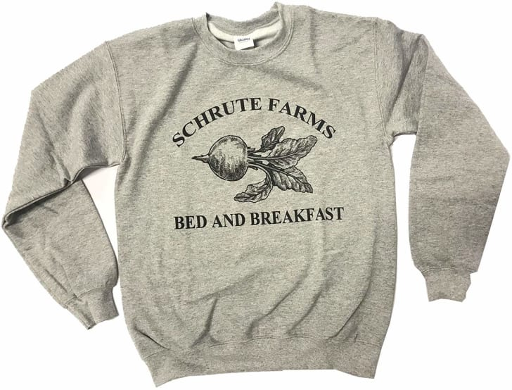 """Image of a gray pullover sweatshirt with a picture of a beet on it in black. In black lettering, surrounding the beet, are the words """"Schrute Farms Bed and Breakfast."""""""