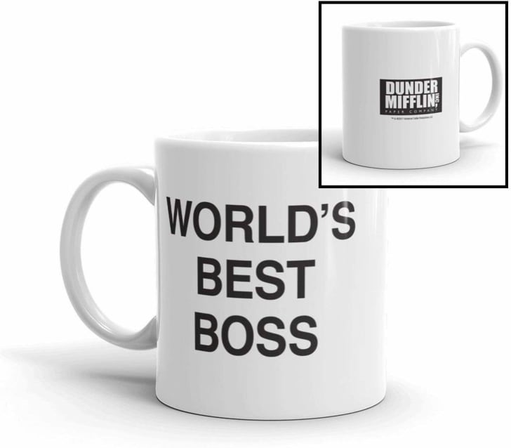 """Image of a white mug with black lettering. The front says """"World's Best Boss"""" and the back features the Dunder Mifflin Paper Company logo"""