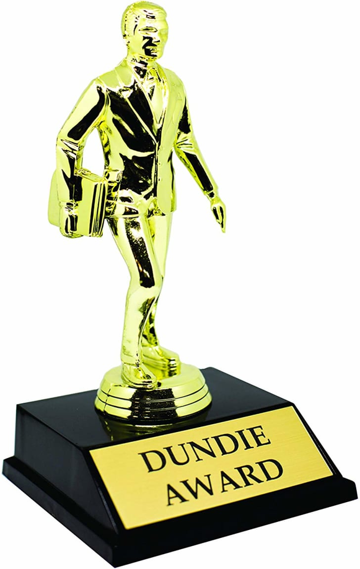 "Image of a gold trophy with a figurine of a businessman. The trophy reads ""Dundie Award"" at the base."
