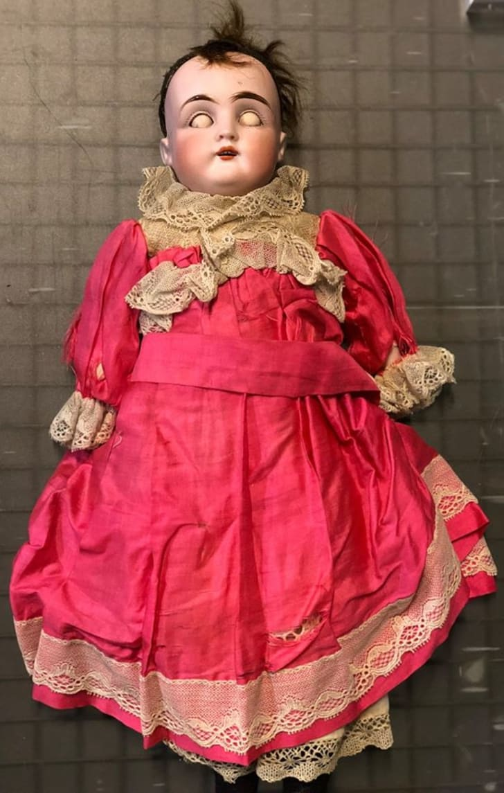 Antique doll with eyes closed.