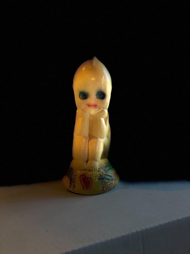 Creepy doll figurine.