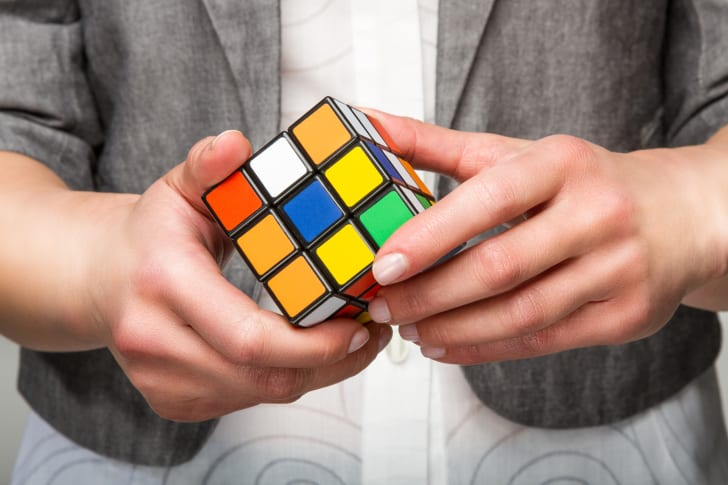 Person playing with a Rubik's Cube