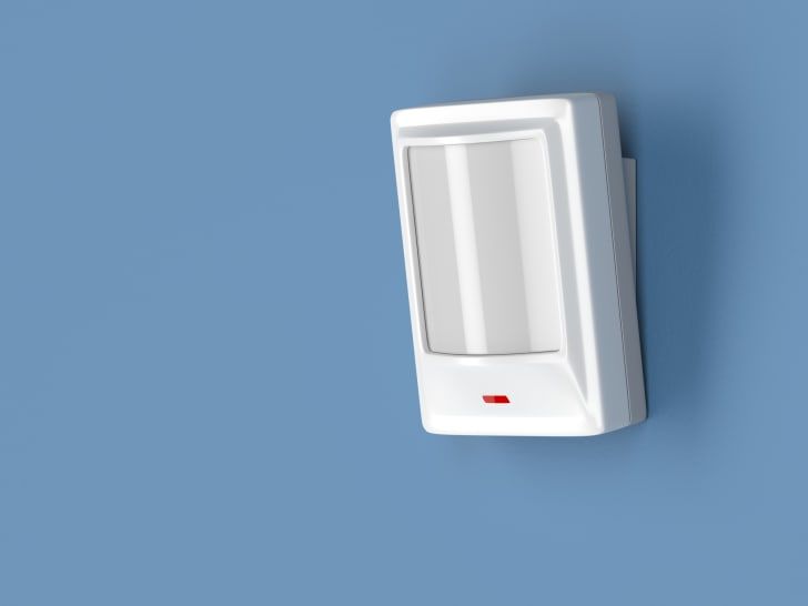 White motion detector on a white wall.