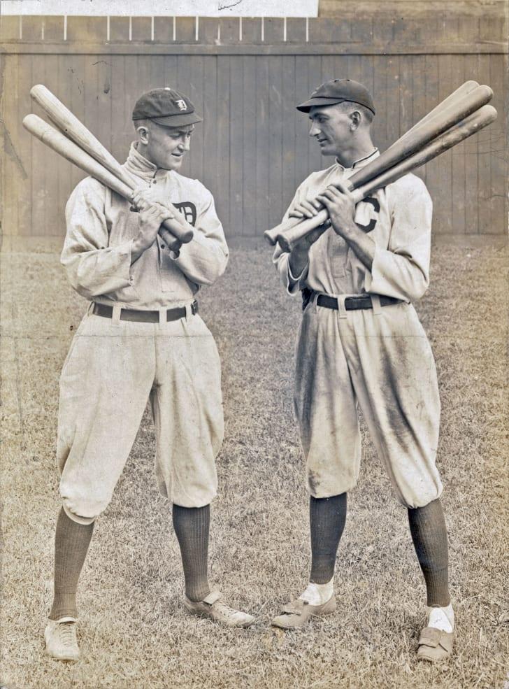 Ty Cobb & Joe Jackson standing alongside each other, each holding bats