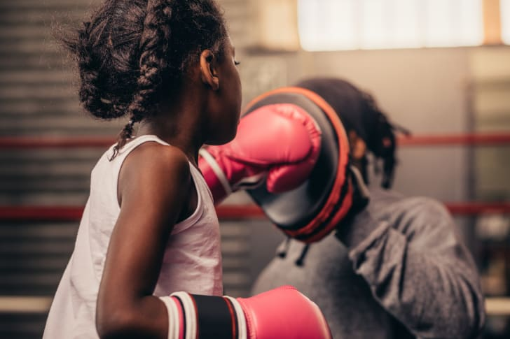 A young girl practices boxing.