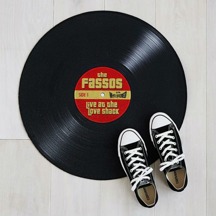 The Personalized Record Doormat from Uncommon Goods is pictured