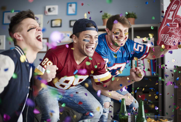 American football fans cheer on their team