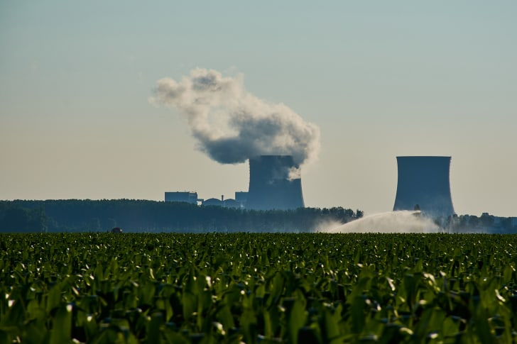 Nuclear power plant behind a field