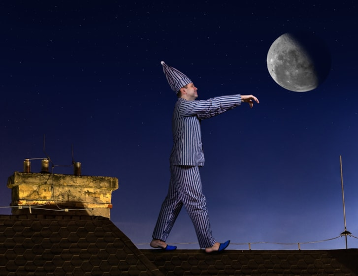 A sleepwalker on a roof