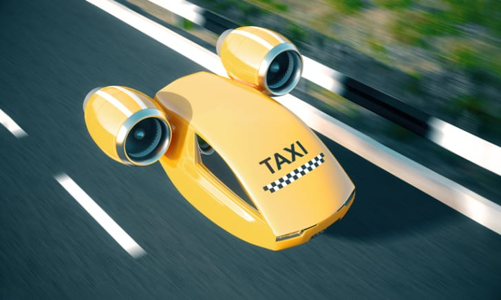 Yellow taxi hovering above the ground