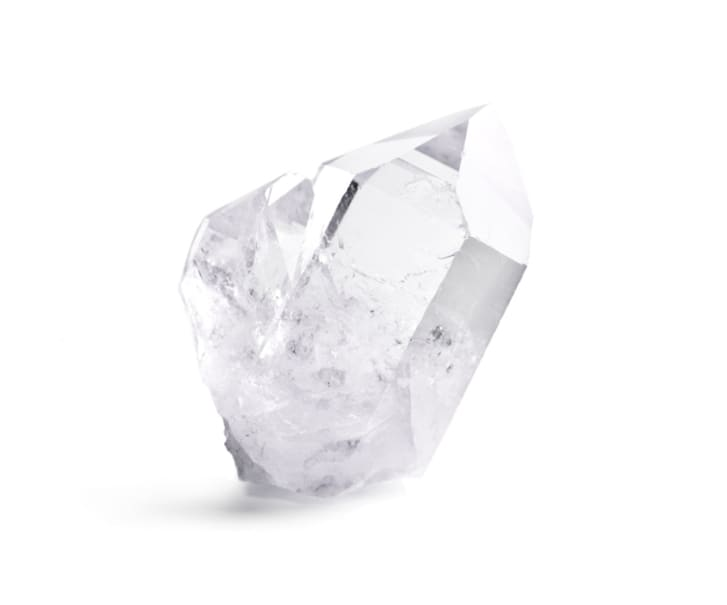 Large double quartz crystal against a white background