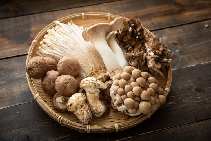 An assortment of mushrooms in a bowl