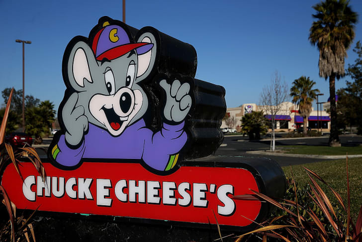 A sign is posted in front of a Chuck E. Cheese restaurant on January 16, 2014 in Newark, California
