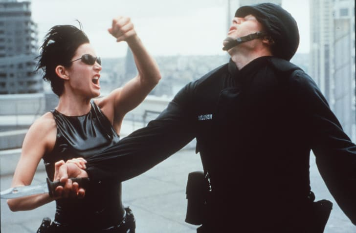 "1999 Carrie-Anne Moss Stars In ""The Matrix."" 1999 Warner Bros. And Village Roadshow Film."