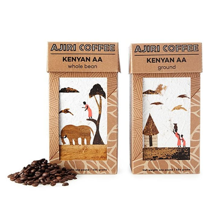 Kenyan Coffee Beans on a white background with boxes featuring artwork.