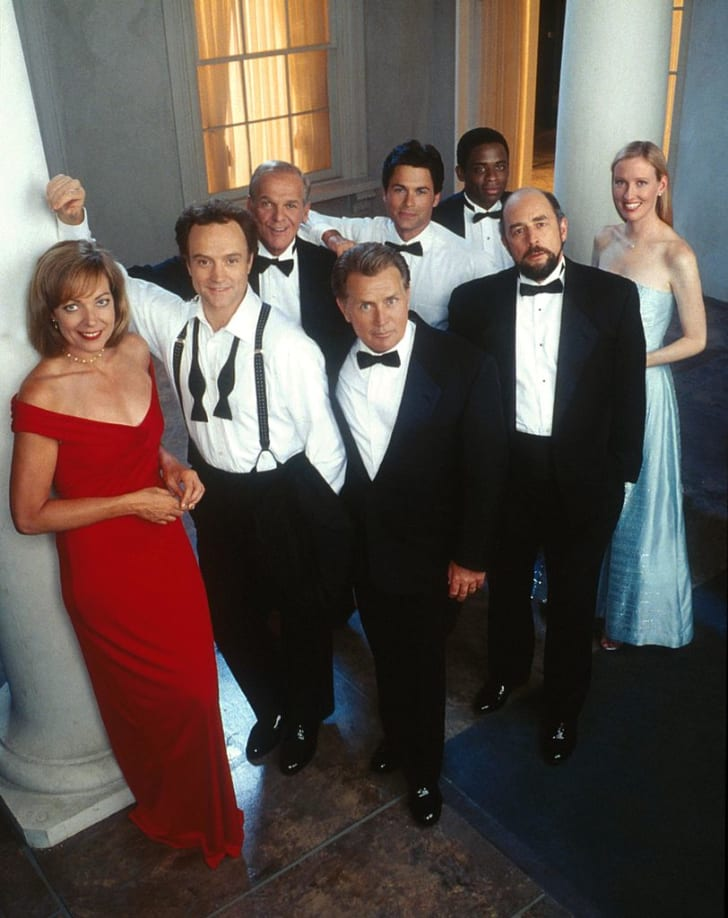 'The West Wing' cast: Front row, L to R: Allison Janney, Bradley Whitford, Martin Sheen, Richard Schiff, and Janel Moloney; Back row,  L to R: John Spencer, Rob Lowe, and Dule Hill