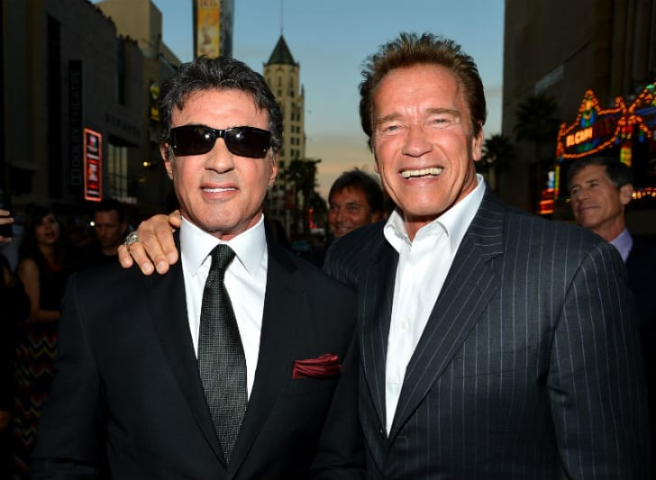 Actors Sylvester Stallone (L) and Arnold Schwarzenegger (R) are photographed during the premiere of 'The Expendables 2' in Hollywood, California in August 2012