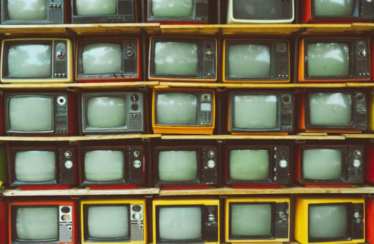 Several vintage televisions are pictured