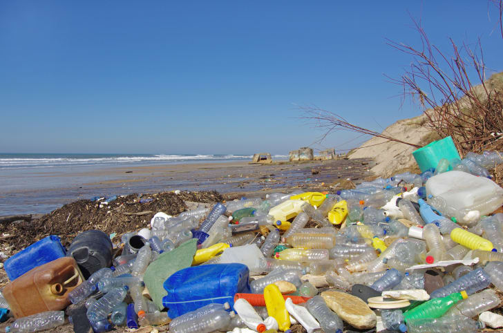 Endless plastic bottles on discarded on the beach.