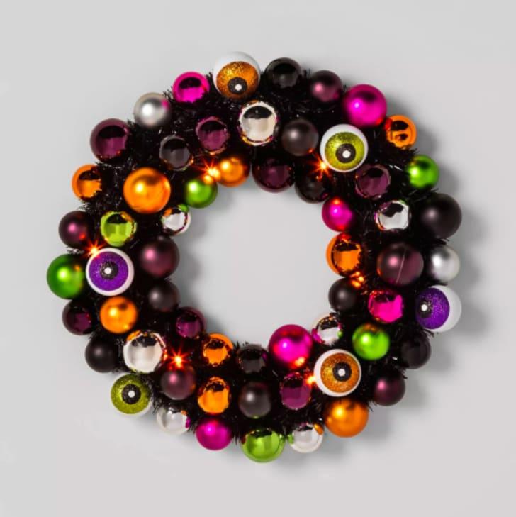 A wreath made of fake eyeballs