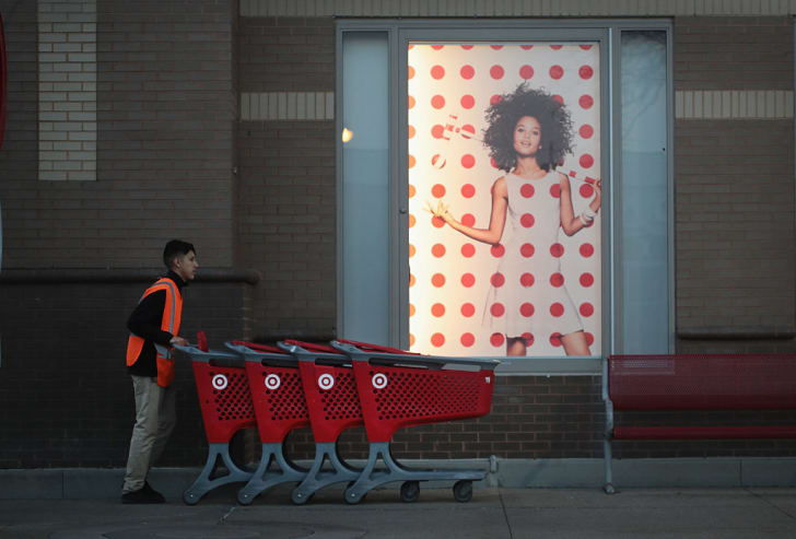 A worker collects shopping carts outside a Target store on November 16, 2016 in Chicago, Illinois