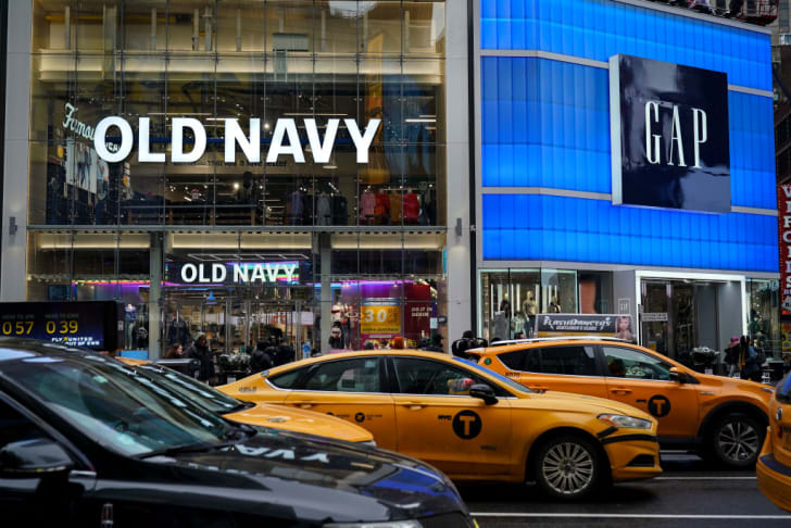 Traffic passes by an Old Navy and GAP stores in Times Square, March 1, 2019 in New York City