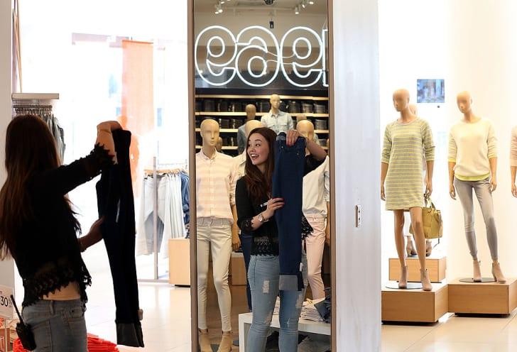 Gap employee Shinju Nozawa-Auclair folds clothes at a Gap store on February 20, 2014 in San Francisco, California