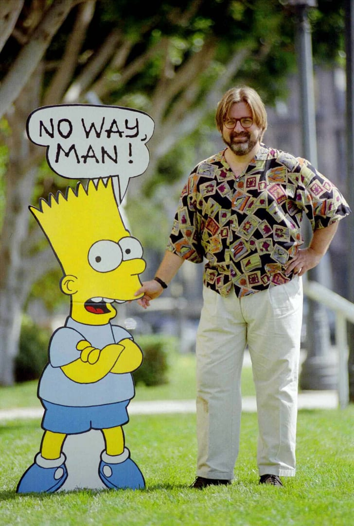 """Cartoonist and creator of """"The Simpsons"""" stands 1992, with a cardboard cutout of Bart Simpson"""