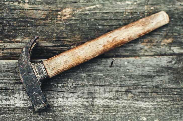 A carpentry hammer on a wooden table