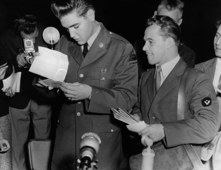 Elvis Presley receiving mail while in the Army, 1958