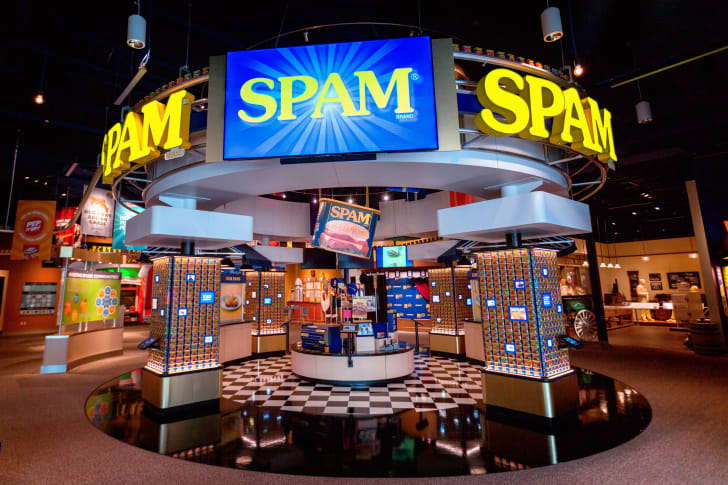 Bright screens and cans of SPAM inside the SPAM museum.
