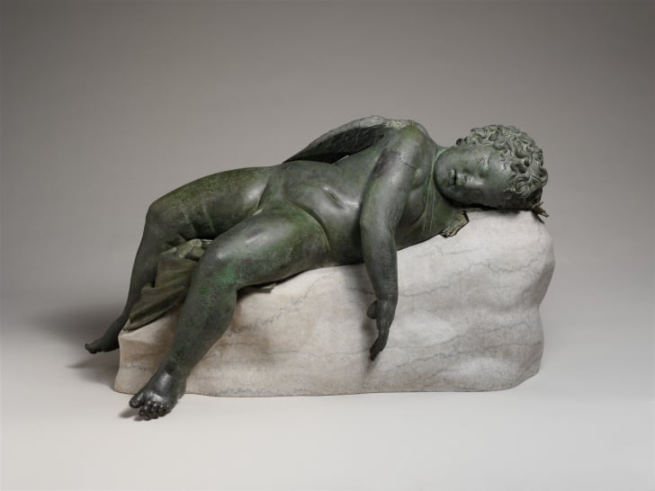 An ancient Greek bronze statue of Eros sleeping, of the type that might have inspired Michelangelo