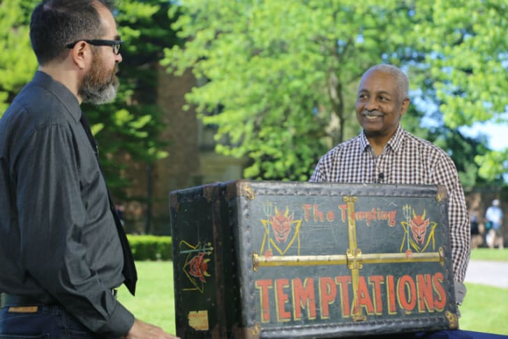 'Antiques Roadshow' appraiser Gary Piattoni examines a trunk that once belonged to the Temptations