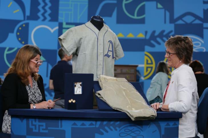 'Antiques Roadshow' appraiser Leila Dunbar (L) evaluates a Randy Gumpert baseball uniform