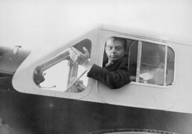 Aviator and 'The Little Prince' author Antoine de Saint-Exupéry is photographed inside of an airplane cockpit in 1935