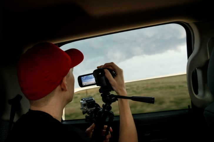Hunter Anderson, a meteorology student at St. Cloud University, films a storm near Limon, Colorado in May 2017