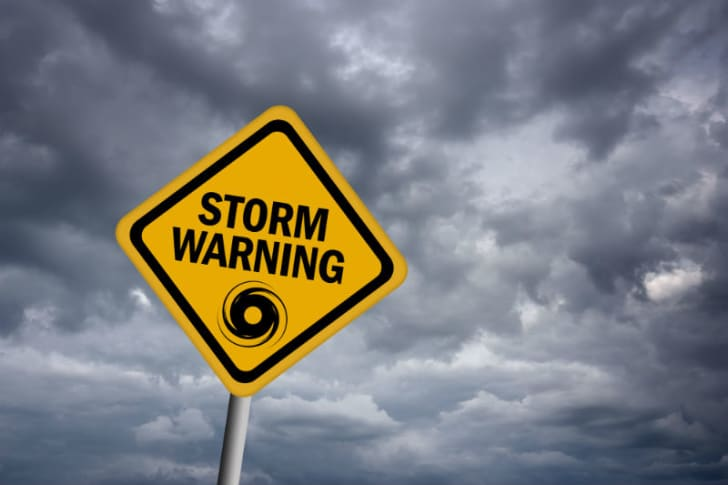 A storm warning sign is pictured