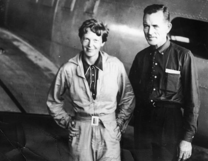 Amelia Earhart with her navigator, Fred Noonan, in the hangar at Parnamerim airfield, Natal, Brazil, on June 11, 1937, before departing for their round-the-world flight