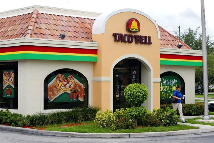 A woman leaves a Taco Bell restaurant in Davie, Florida